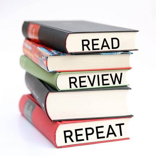 A stack of books and words Read - Review - Repeat